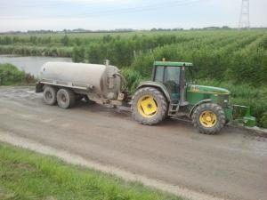 Tractor met waterwagen